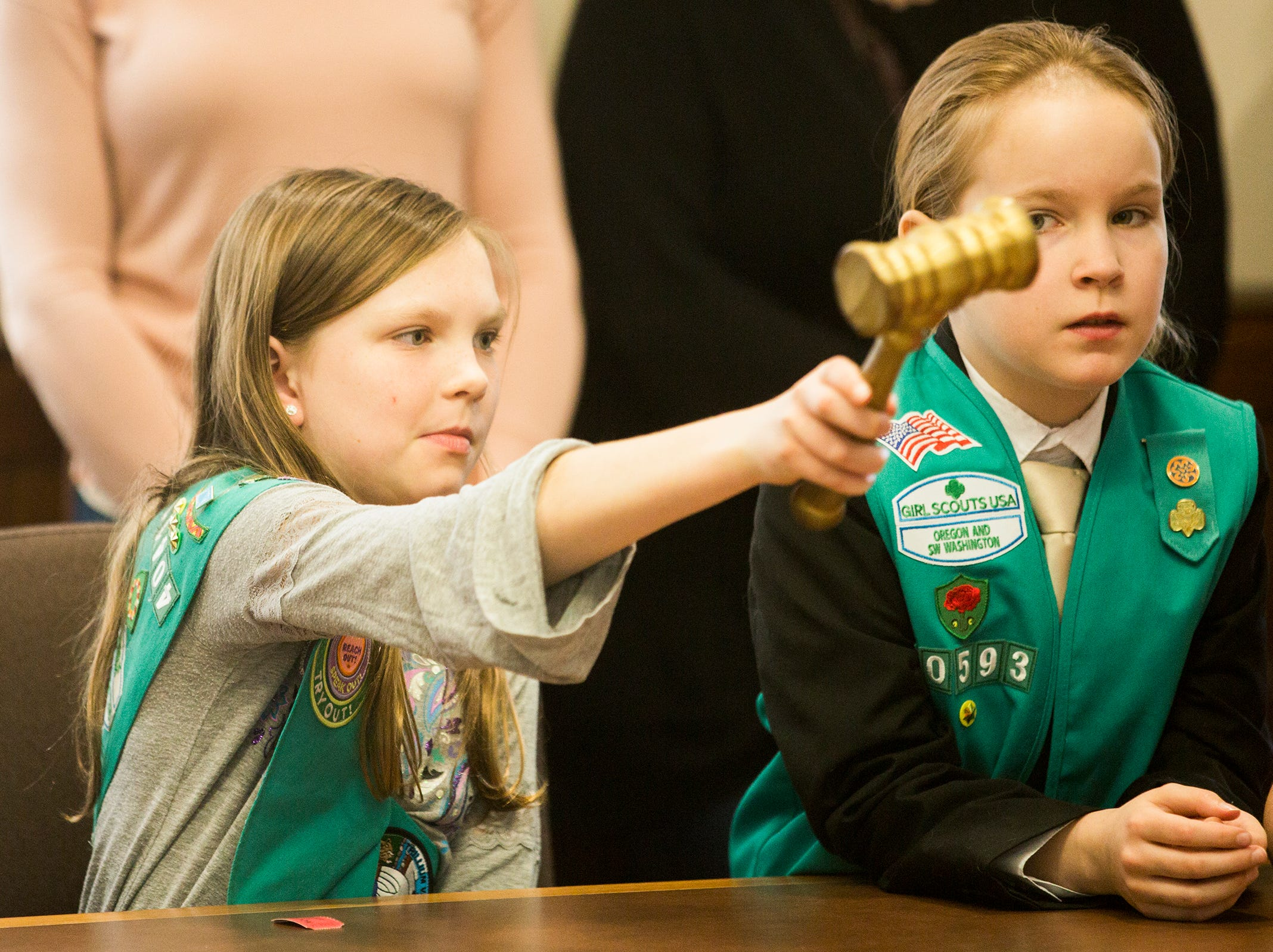 Molly Hughart, of Tigard, and Jaydian Lewis, of Portland, ask questions to a panel of members of the Oregon Legislature during Girl Scout Leadership Day at the Oregon State Capitol in Salem March 12, 2019.