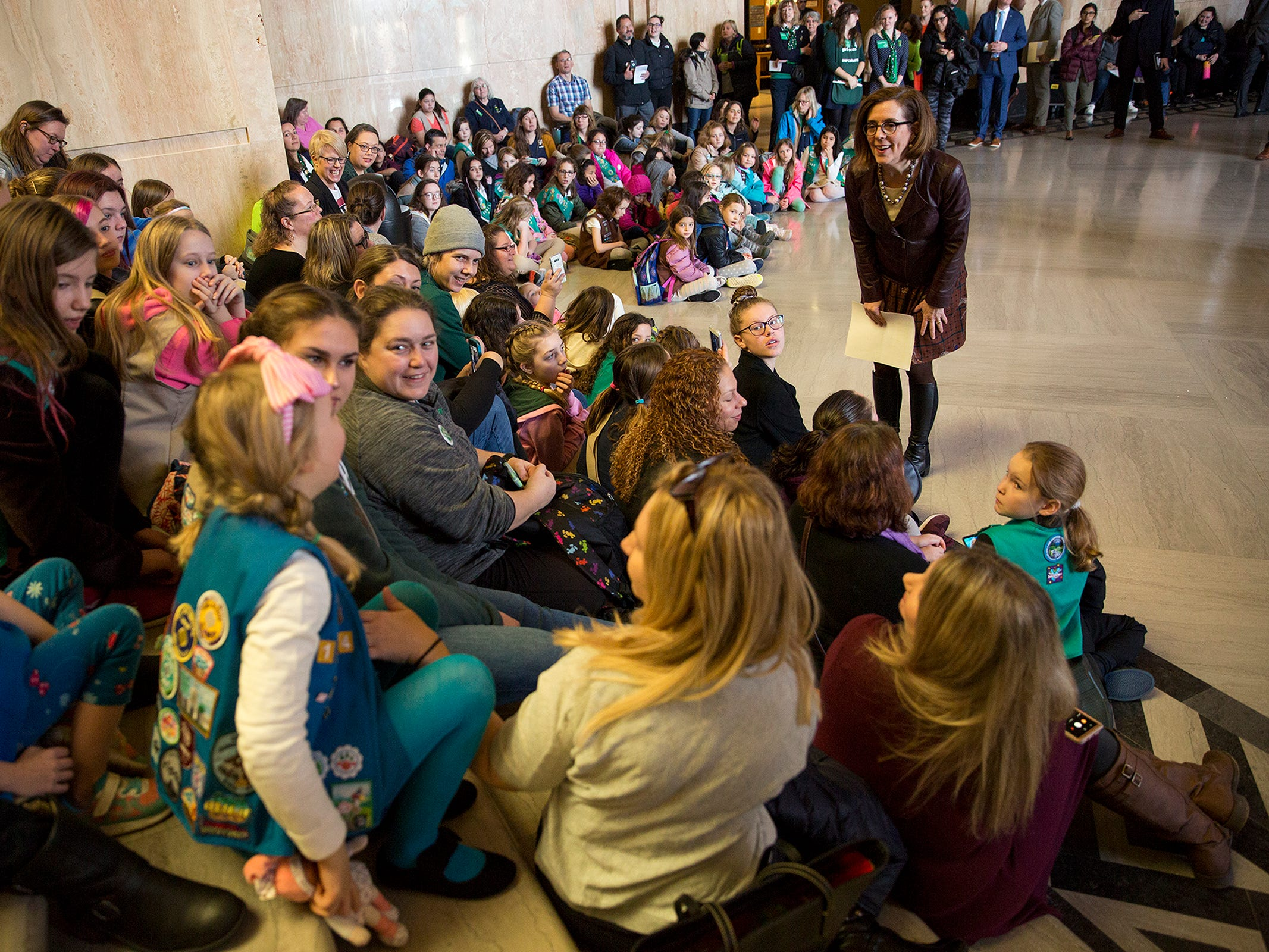 Gov. Kate Brown asks Girl Scouts from across the state what their favorite part about being in the program is during Girl Scout Leadership Day at the Oregon State Capitol in Salem March 12, 2019.