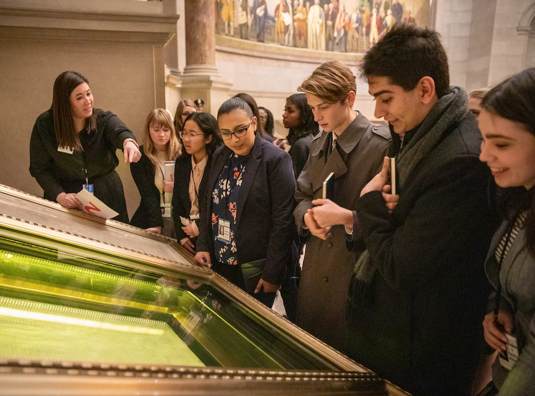 Students see the U.S. Constitution on display at the National Archives Building as part of the 57th annual United States Senate Youth Program held in Washington, D.C., on March 2-9, 2019.