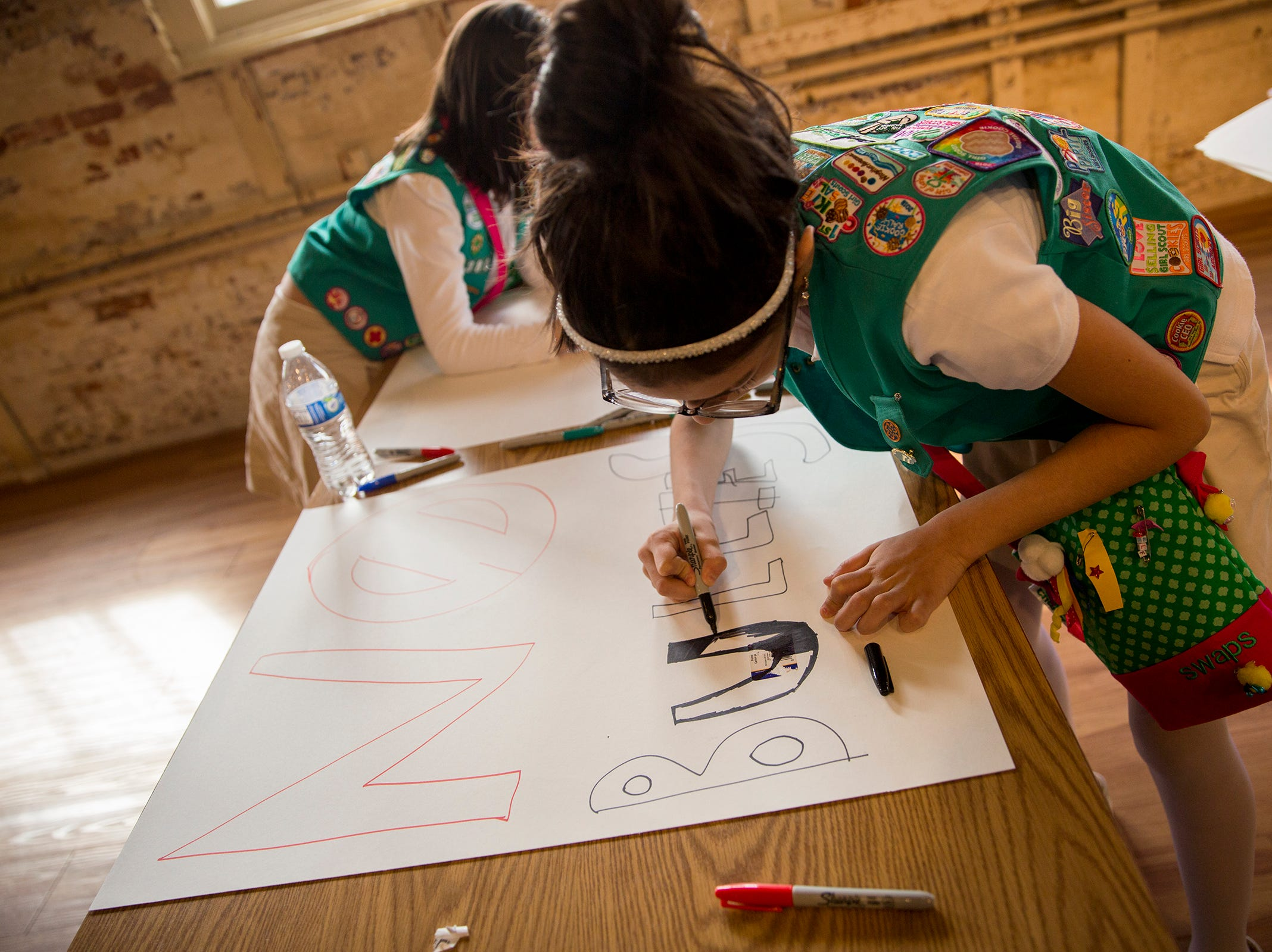 "Charlene Olguin, of Troutdale, writes a ""No Bullies"" sign during Girl Scout Leadership Day at the Willamette Heritage Center in Salem March 12, 2019."
