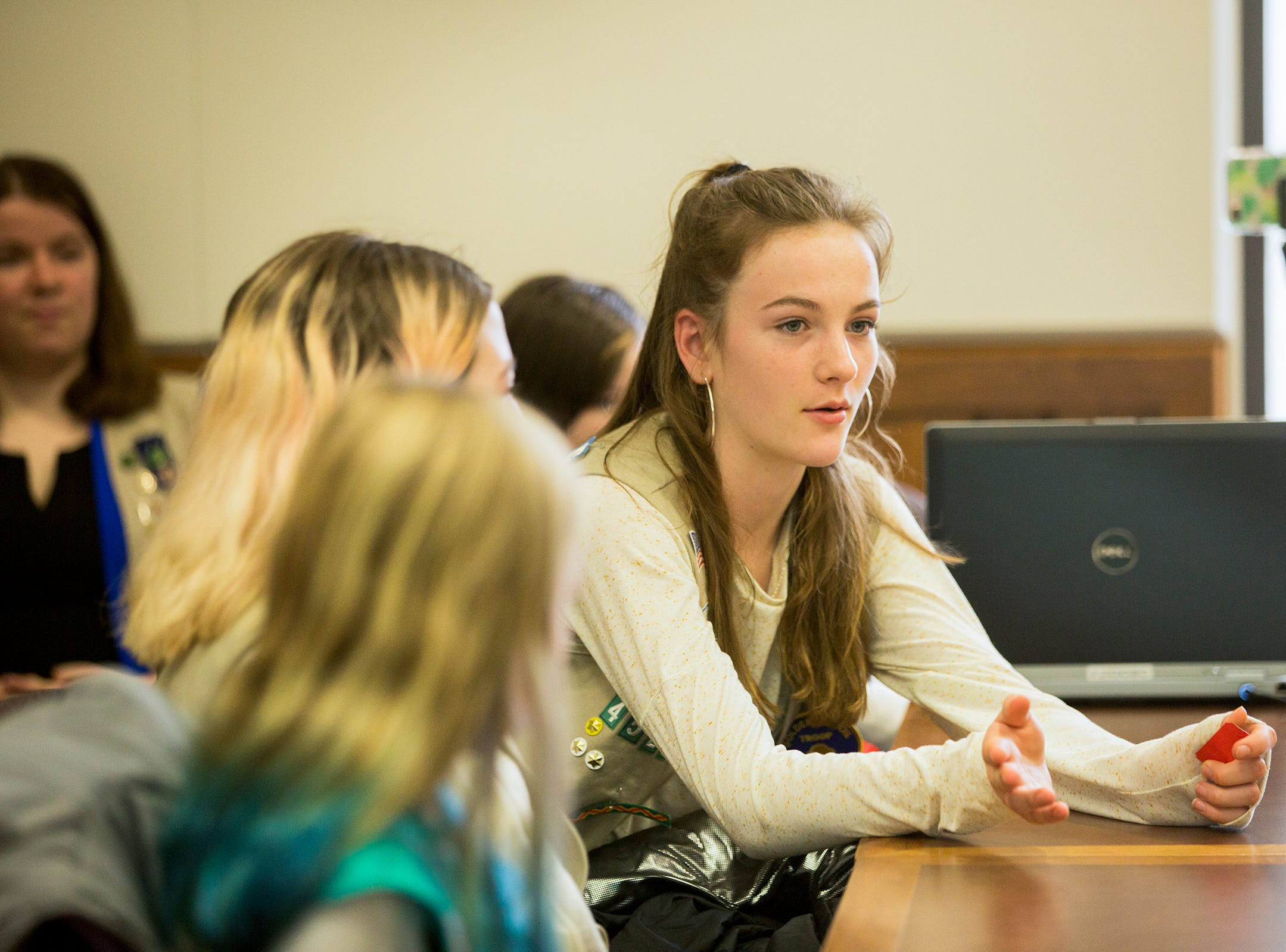 Hannah Doty, of Portland, asks a panel of members of the Oregon Legislature how gender is dealt with in their work environment during Girl Scout Leadership Day at the Oregon State Capitol in Salem March 12, 2019.