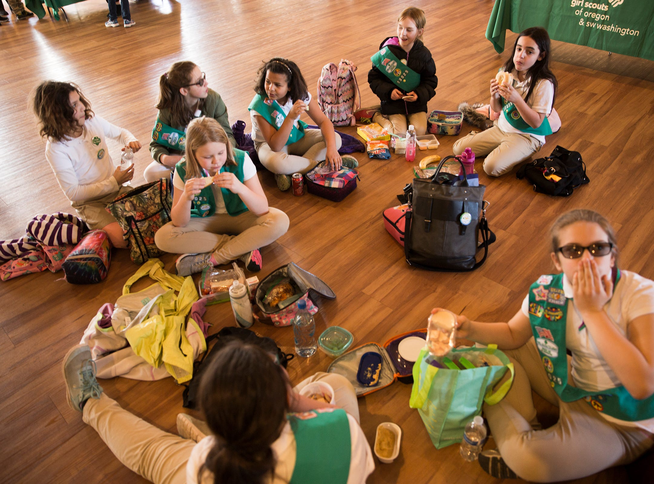 Girl Scouts from Eugene eat lunch during Girl Scout Leadership Day at the Willamette Heritage Center in Salem March 12, 2019.