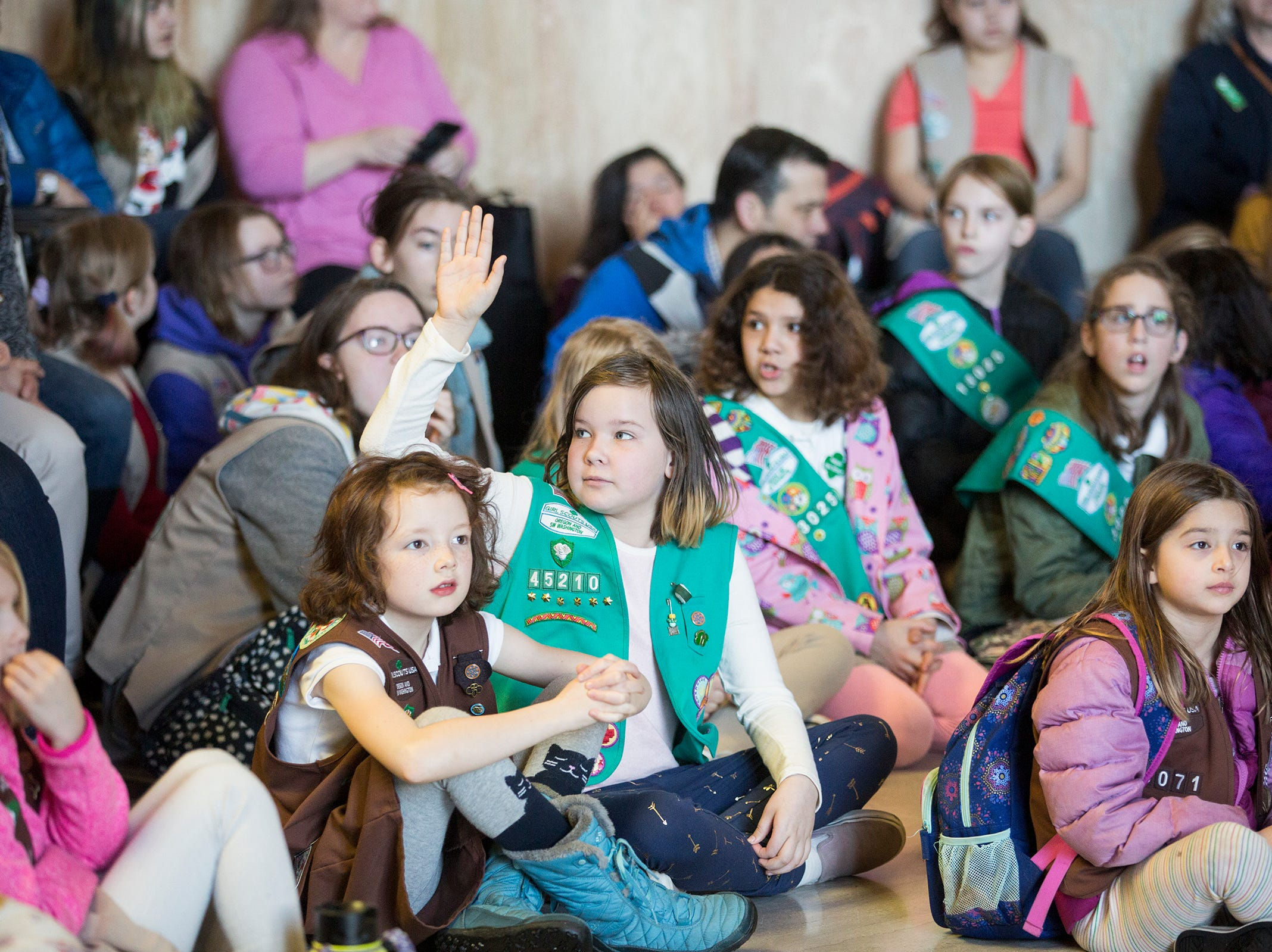 Girl Scouts answer questions from Gov. Kate Brown during Girl Scout Leadership Day at the Oregon State Capitol in Salem on March 12, 2019.