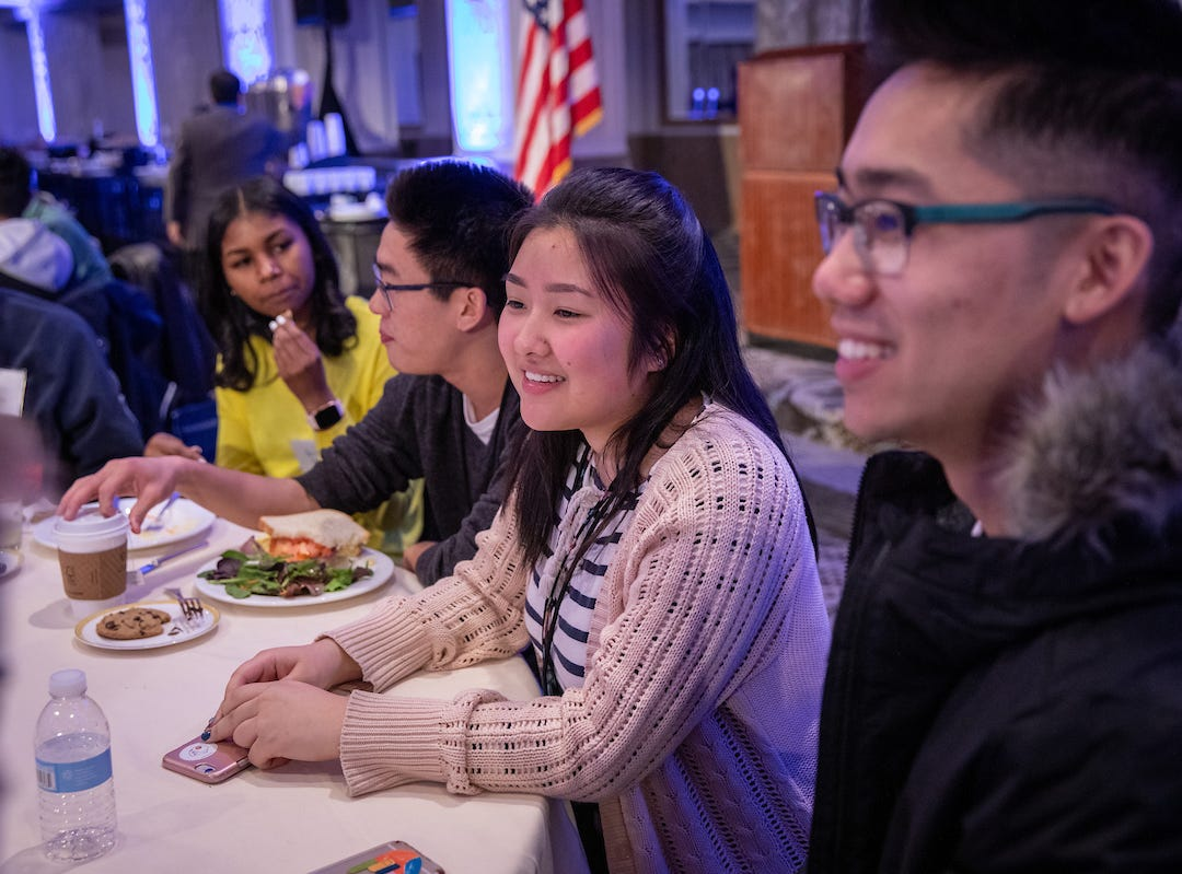 West Salem High School senior Justin Thach, right, sits with peers for a meal during the 57th annual United States Senate Youth Program held in Washington, D.C., on March 2-9, 2019.
