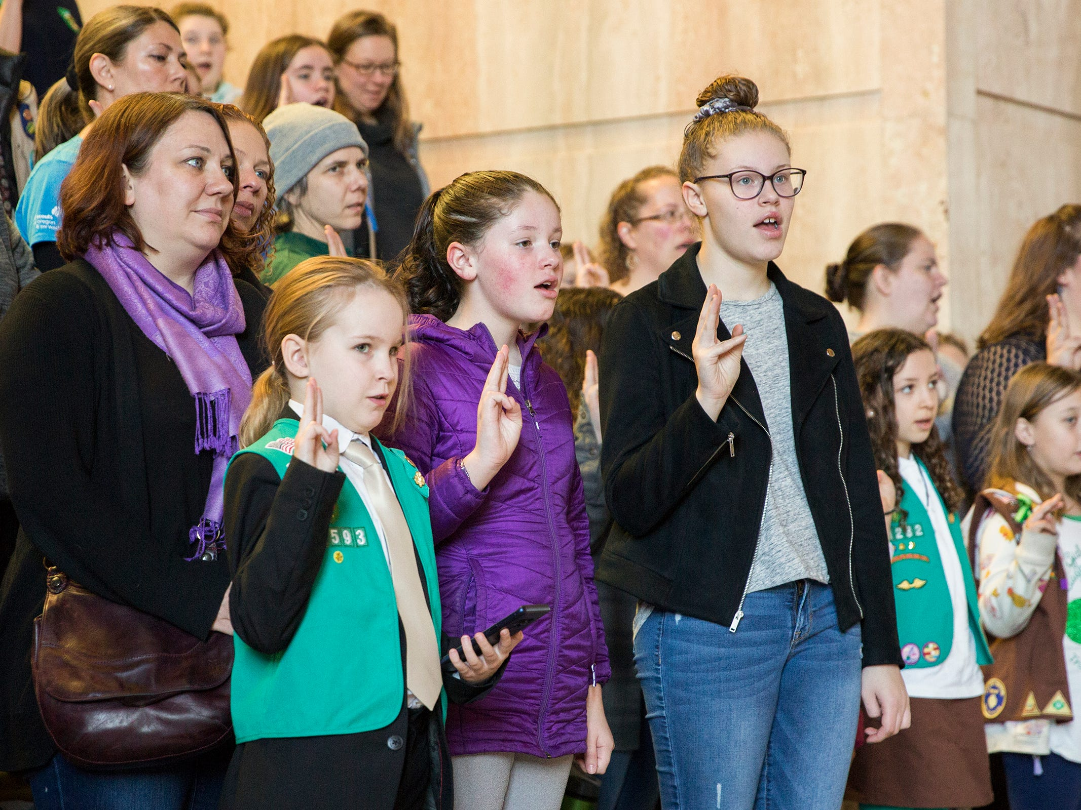 Girl Scouts from across Oregon recite the Girl Scout Promise during Girl Scout Leadership Day at the Oregon State Capitol in Salem March 12, 2019.