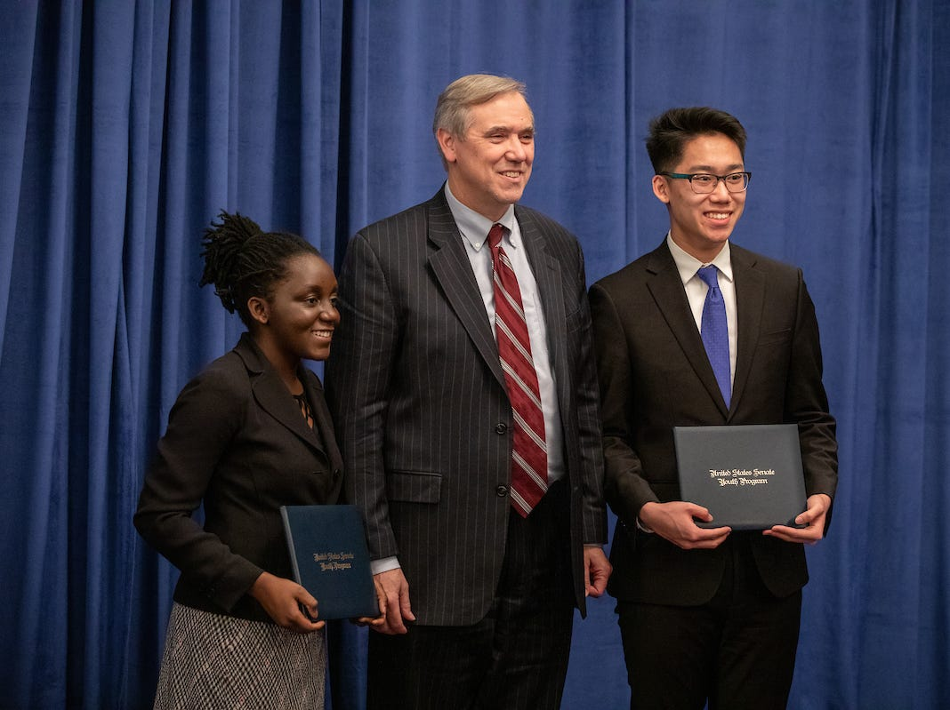 Salem-Keizer seniors Kudzai Kapurura, left, and Justin Thach, right, pose for a photo with Sen. Jeff Merkley, D-Oregon, during the 57th annual United States Senate Youth Program held in Washington, D.C., on March 2-9, 2019.