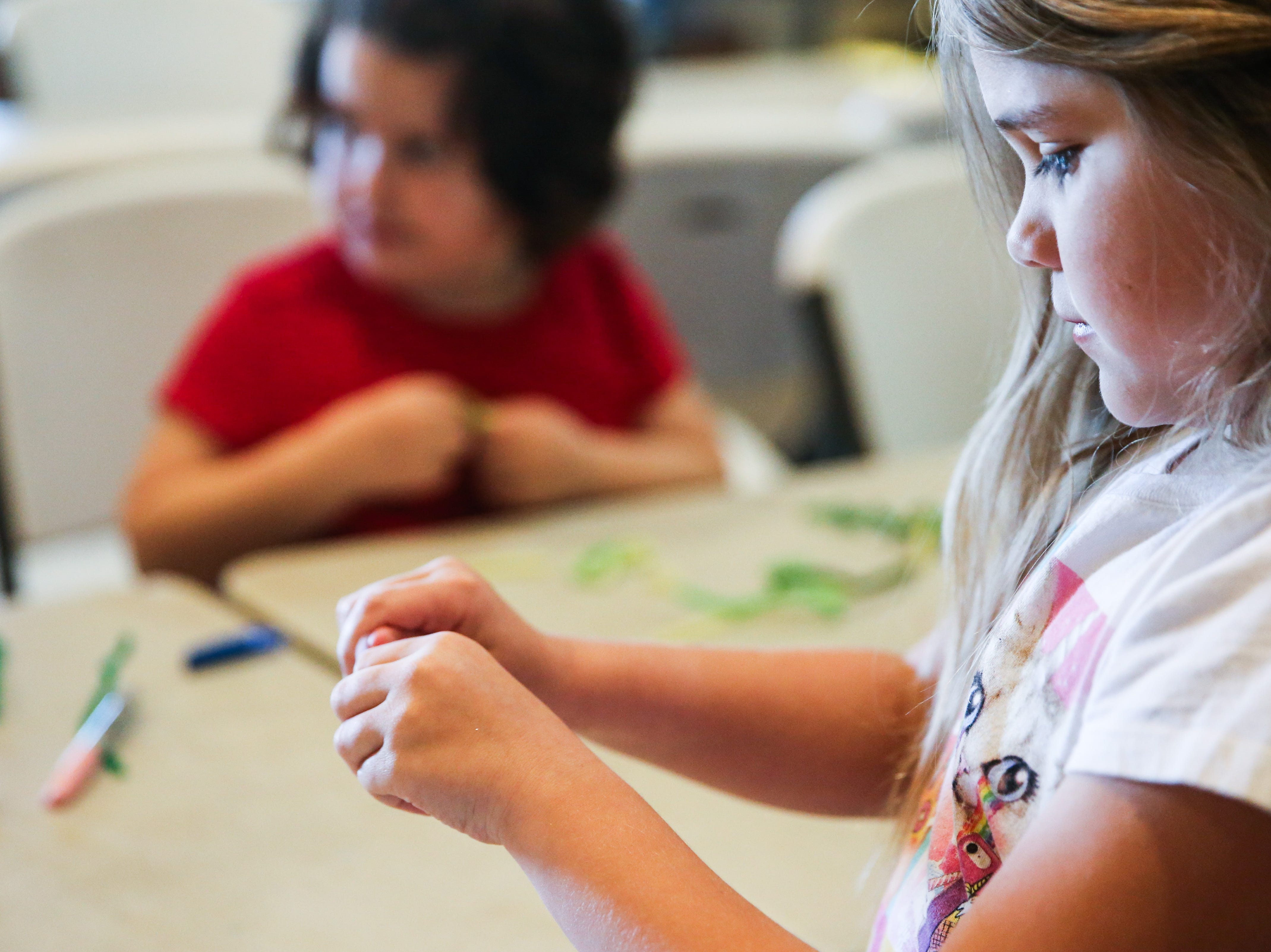 Kennedy Thompson makes pipe animals during spring break camp Wednesday, March 13, 2019, at San Angelo Nature Center.