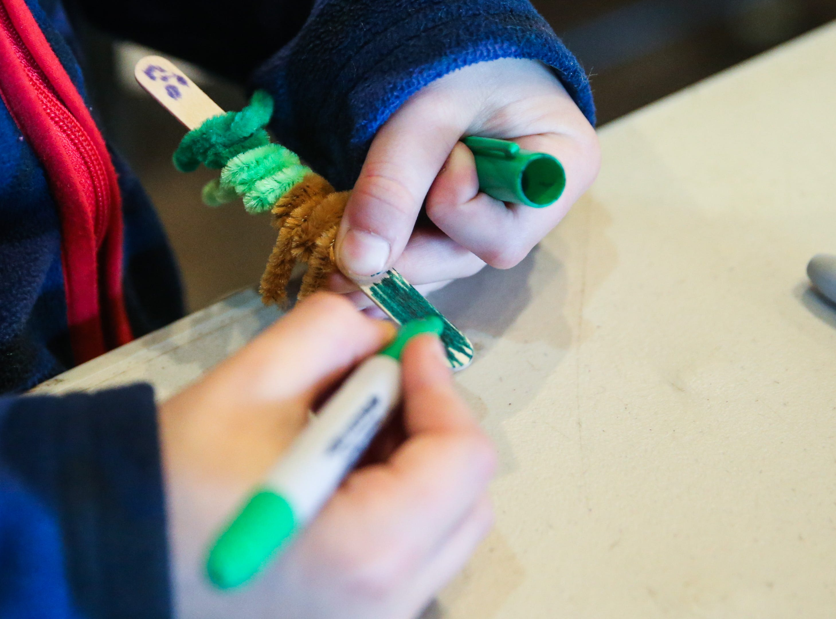Children make pipe animals during spring break camp Wednesday, March 13, 2019, at San Angelo Nature Center.