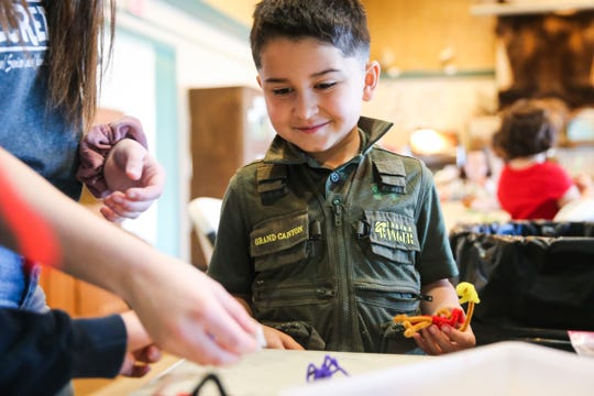 Jaden Cereceres makes pipe animals during spring break camp Wednesday, March 13, 2019, at the San Angelo Nature Center.