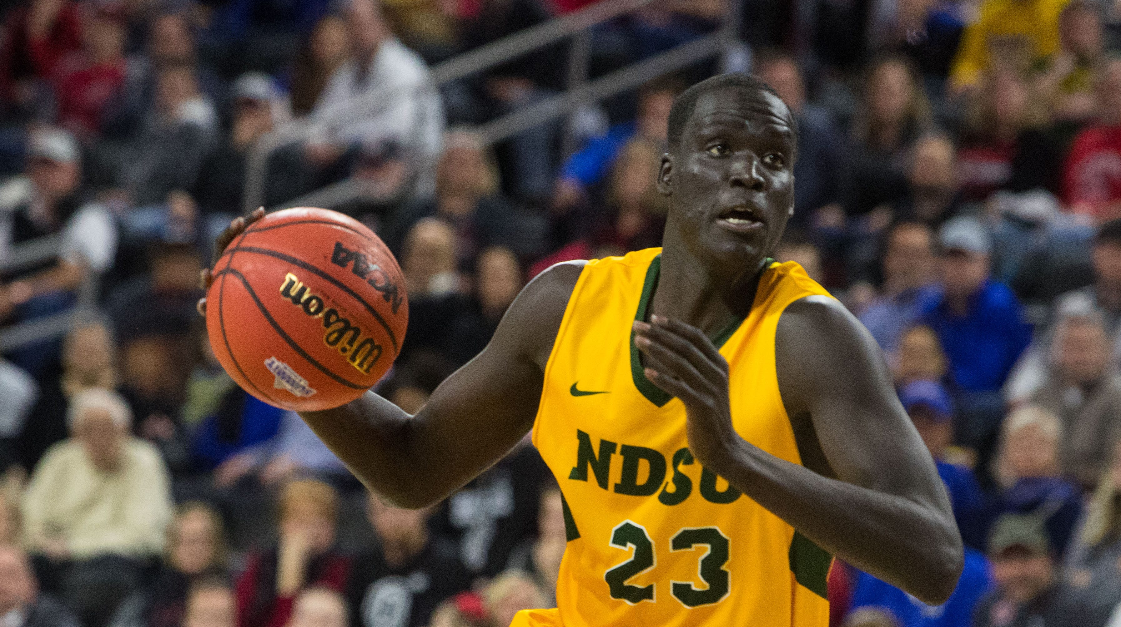 North Dakota State's Deng Geu (23) dribbles the ball during the game against Omaha at the 2019 Summit League Men's Championship at the Denny Sanford Premier Center  in Sioux Falls, S.D., Tuesday, March 12, 2019.
