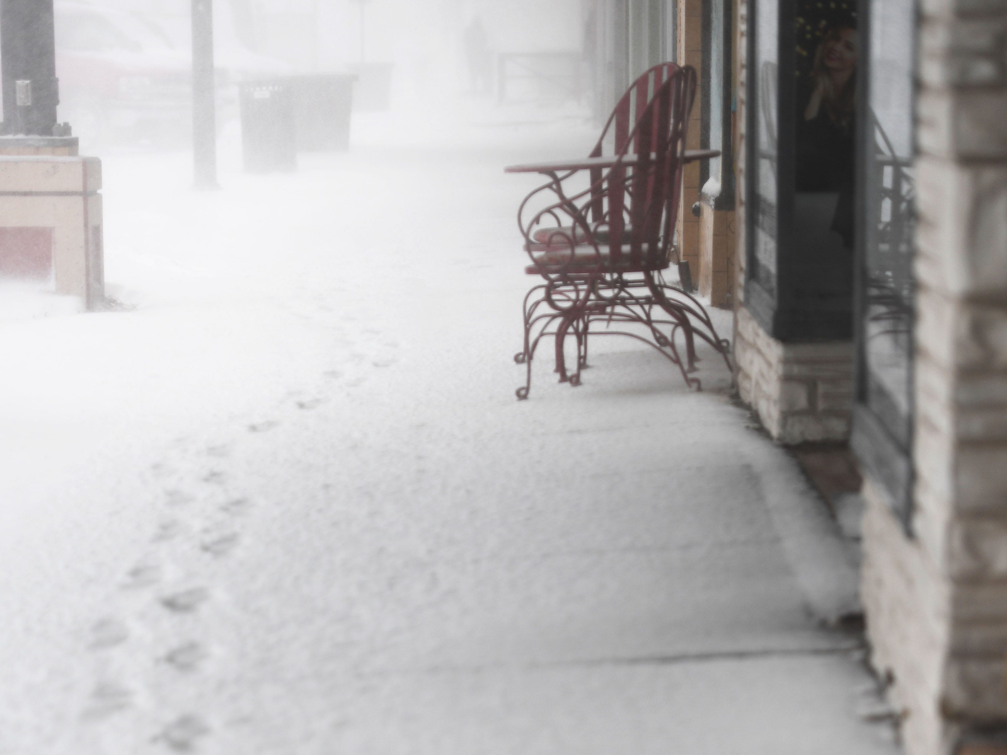Foot prints in the snow during a blizzard in Rapid City Wednesday, March 13, in Rapid City, S.D.