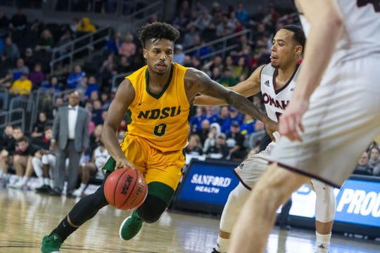 North Dakota State's Vinnie Shahid (0) dribbles the ball during the game against Omaha at the 2019 Summit League Men's Championship at the Denny Sanford Premier Center  in Sioux Falls, S.D., Tuesday, March 12, 2019.