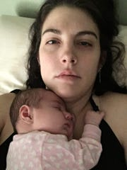 Shelly Conlon's daughter rests on her chest in December, about three weeks after birth.