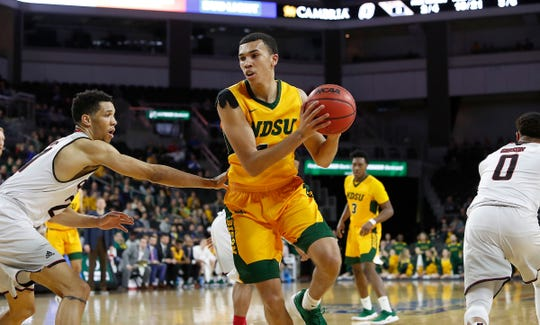 SIOUX FALLS, SD - MARCH 12: Tyson Ward #24 from North Dakota State moves around Zach Jackson #21 from Omaha during the men's championship at the 2019 Summit League Basketball Tournament at the Denny Sanford Premier Center in Sioux Falls. (Photo by Dick Carlson/Inertia)