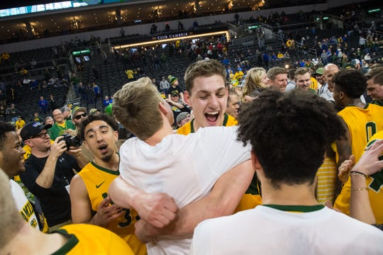 North Dakota State players celebrate winning the 2019 Summit League Men's Championship at the Denny Sanford Premier Center in Sioux Falls, S.D., Tuesday, March 12, 2019.