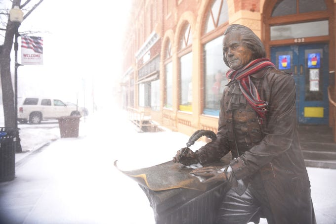 A statue of Thomas Jefferson braves the blizzard in downtown Rapid City Wednesday, March 13, in Rapid City, S.D.