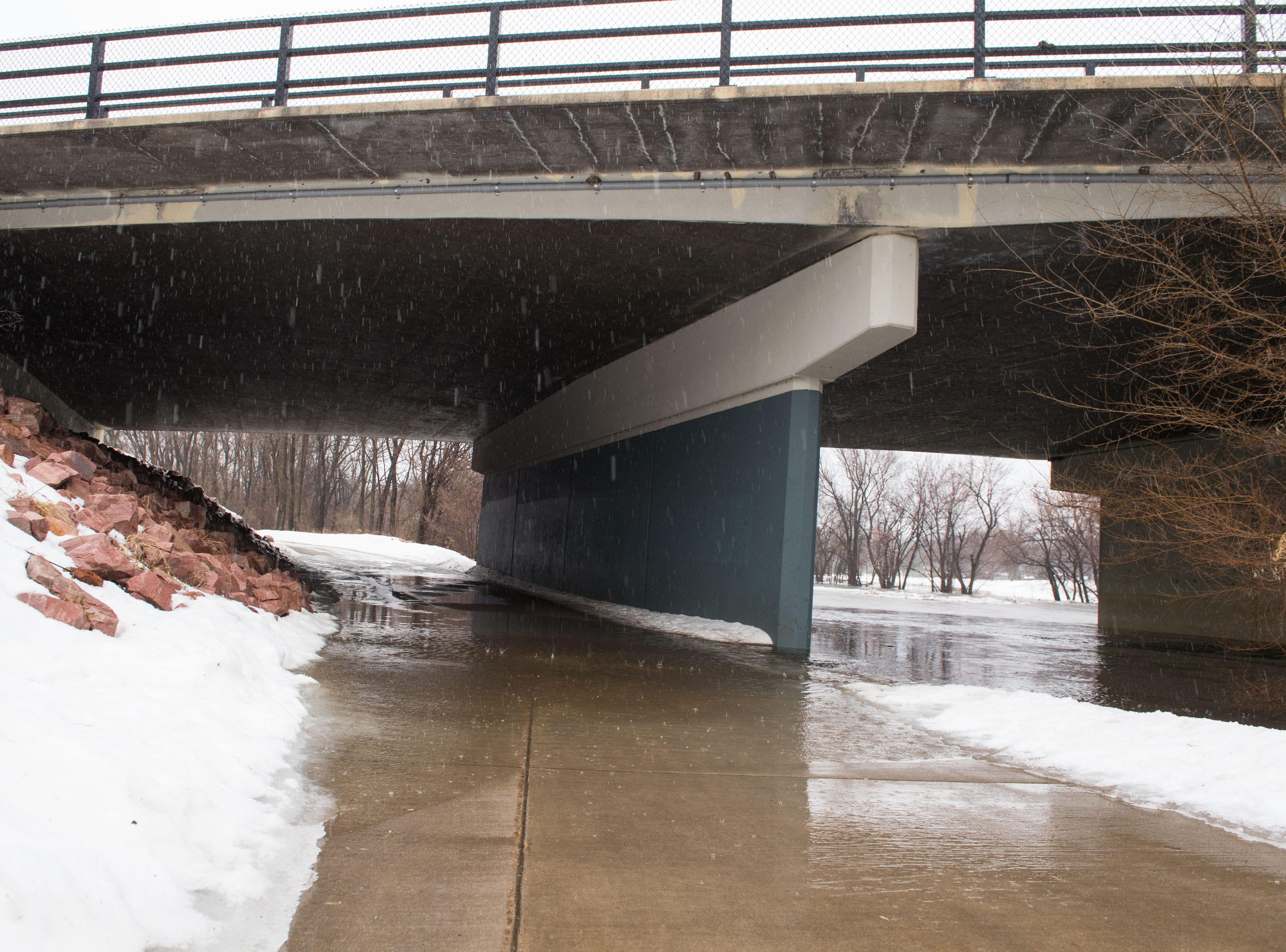 The bike trail at Yankton Trail Park in Sioux Falls, S.D. begins to flood, Wednesday, March 13, 2019.