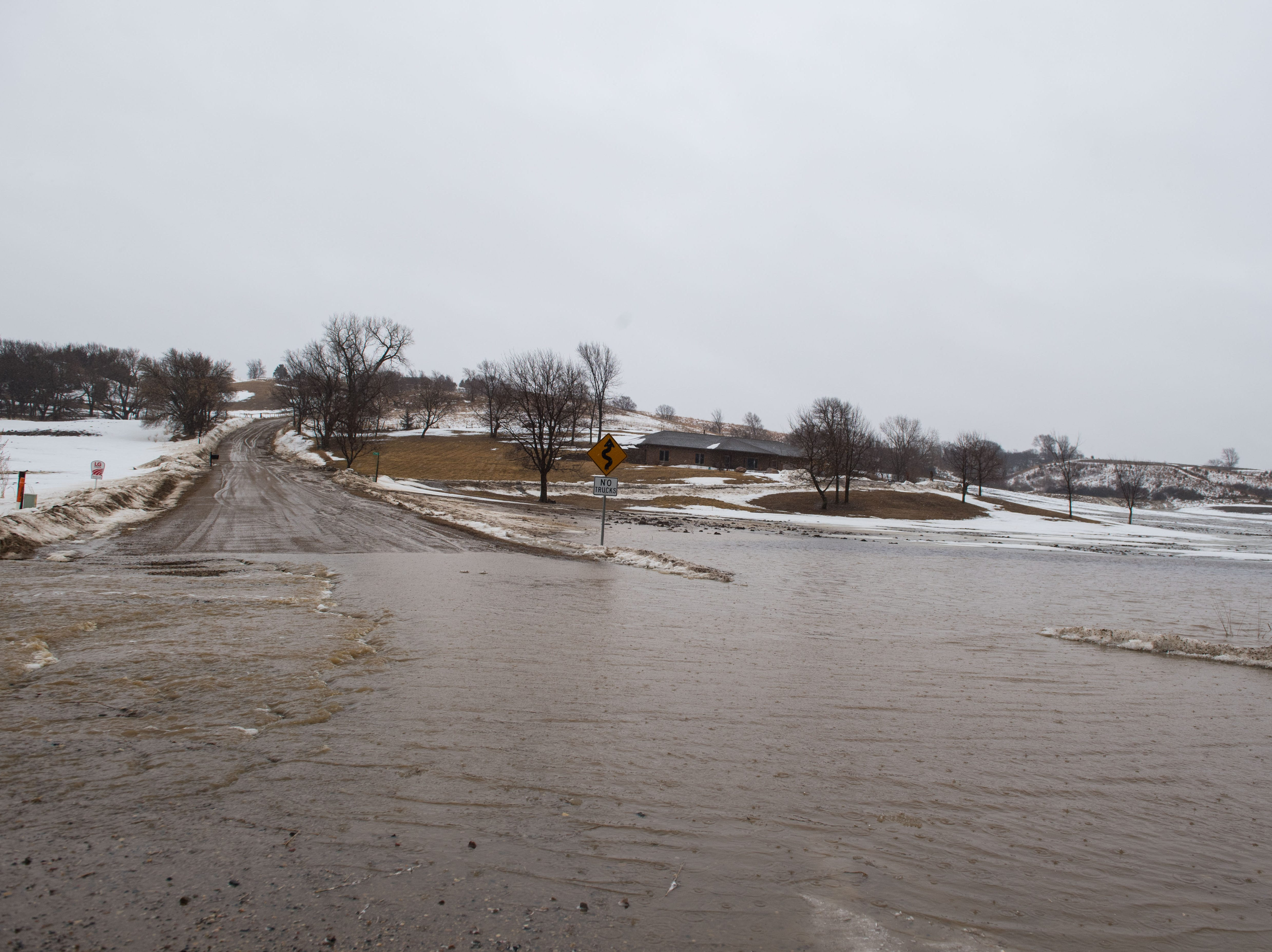 Road starts to flood near Canton, S.D. and the Iowa boarder, Wednesday, March 13, 2019.
