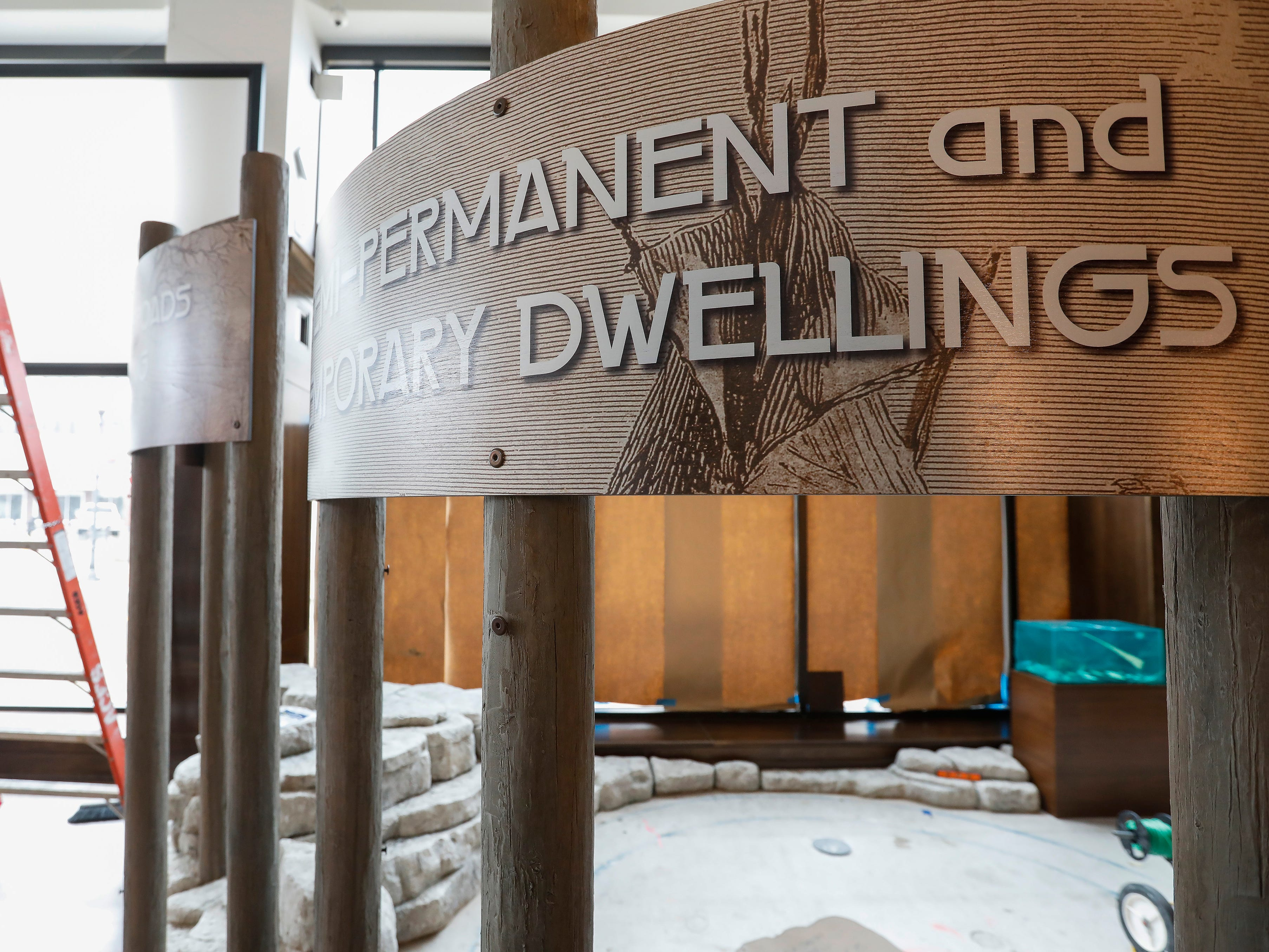 Signs indicate what visitors will see in the section dedicated to Native Americans at the History Museum on the Square.
