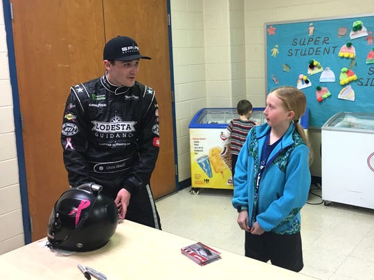 Quin Houff, a driver on NASCAR's Monster Energy Series, was the special guest at Clymore Elementary Tuesday, meeting students as part of the school's Reading Family Fun Night.