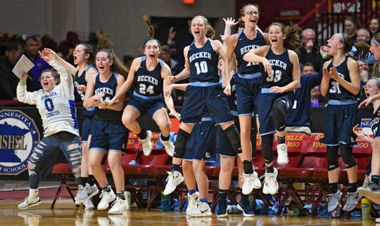 Becker players react to their team's last-second basket against Marshall for the 68-67 win in the state Class 3A quarterfinals Wednesday, March 13, in Minneapolis.