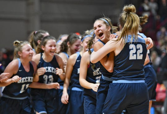 Becker players celebrate following their 68-67 win against Marshall in the state Class-3A quarterfinals Wednesday, March 13, in Minneapolis.