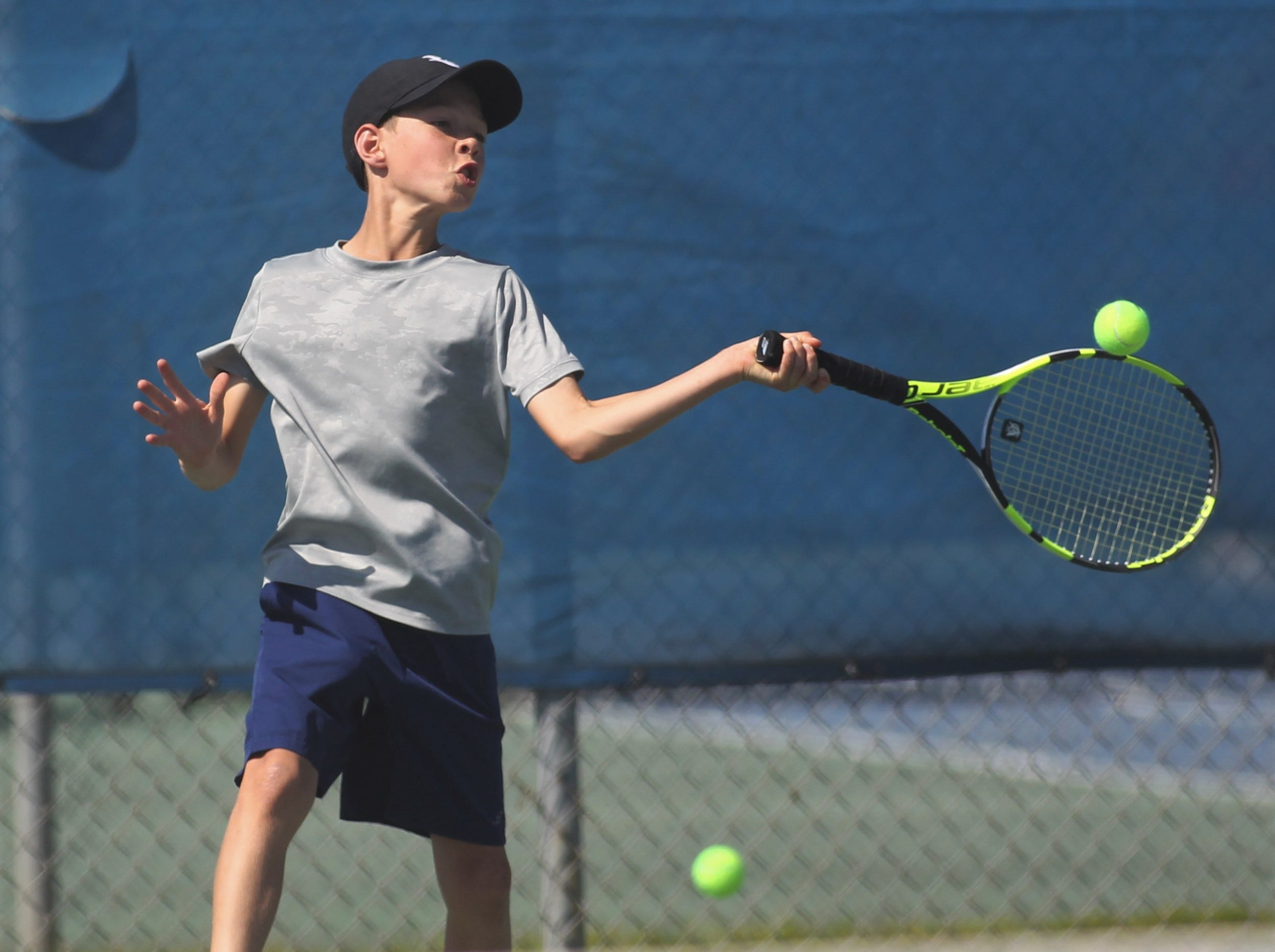 Community Christian plays during the boys and girls tennis 2019 City Tournament at Tom Brown Park on March 12, 2019.