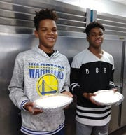 From right to left, Zy'Kayvious Reese and Josaiah Knight hold pies at West Gadsden Middle School.