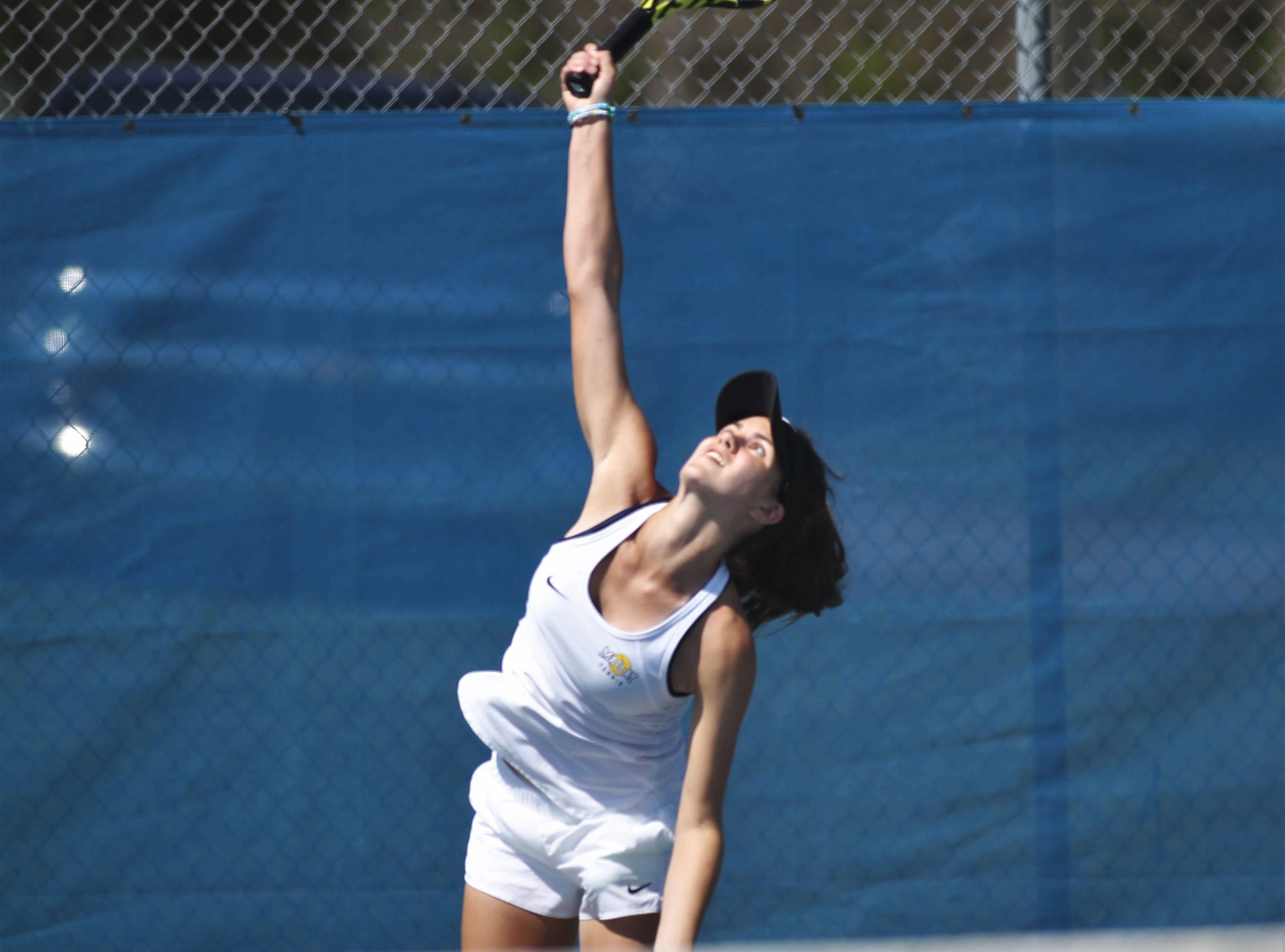 Maclay sophomore Madison Perkins hits a serve during the boys and girls tennis 2019 City Tournament at Tom Brown Park on March 12, 2019.