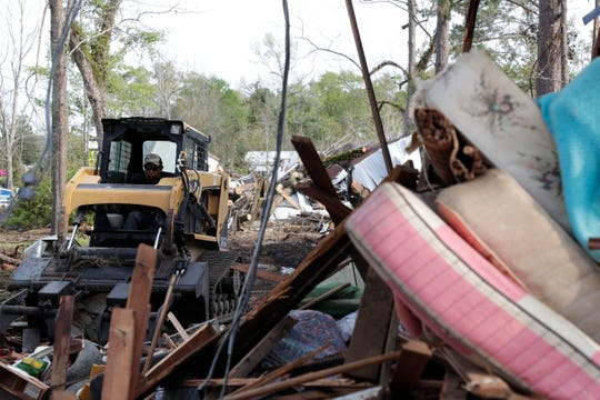 A man uses an excavator to dispose of the remnants of a house used for storage in Quincy. Gadsden County continues to recover from Hurricane Michael, which hit the Panhandle in October 2018.