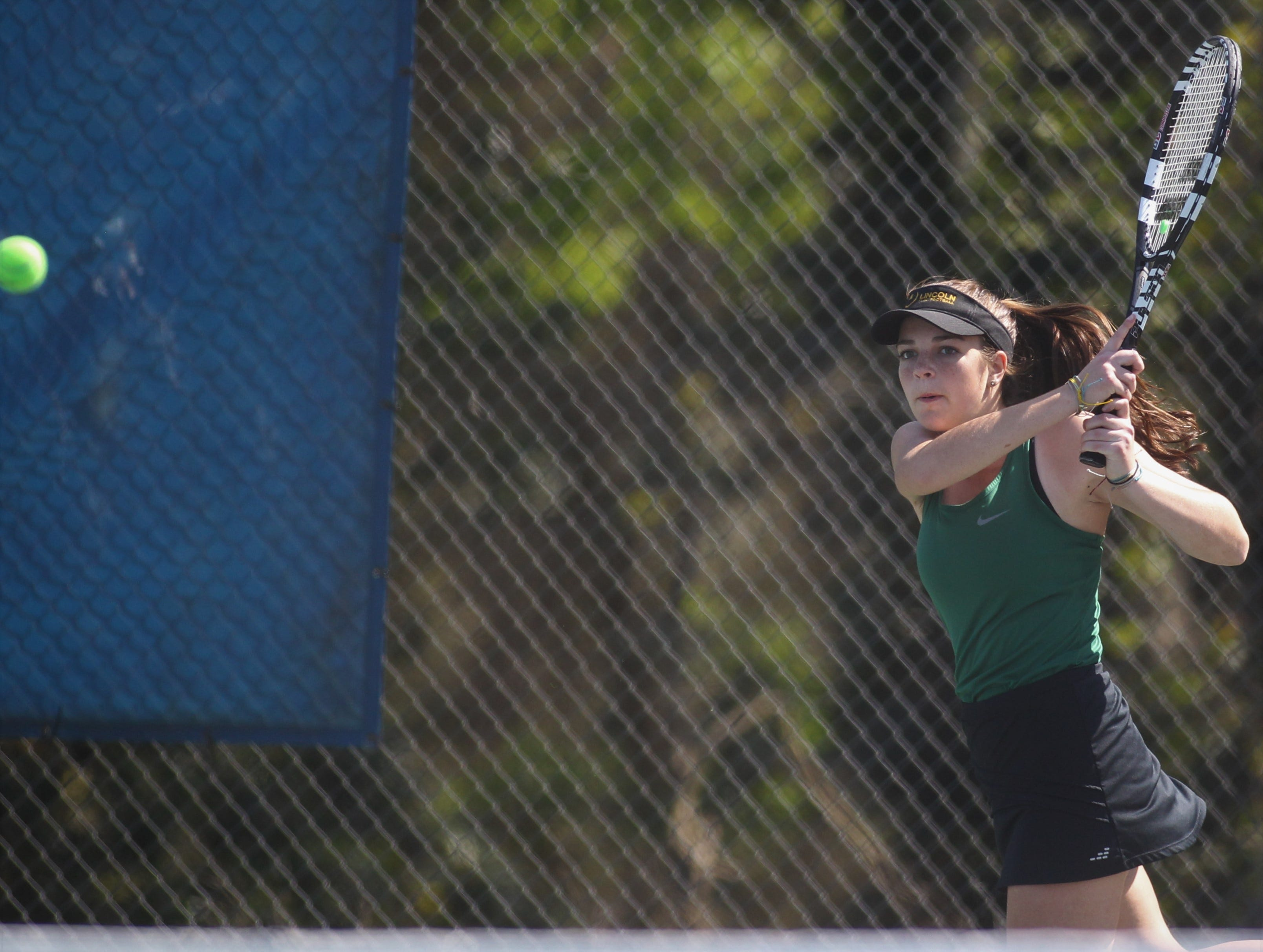 Lincoln senior Kailey Williams hits a return shot during the boys and girls tennis 2019 City Tournament at Tom Brown Park on March 12, 2019.