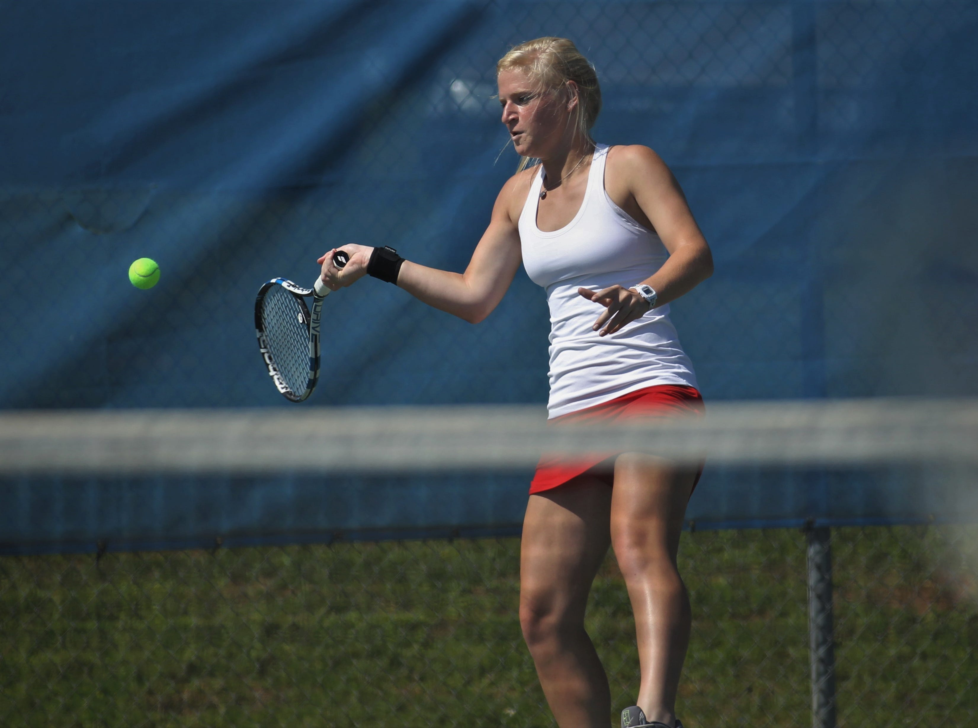 Leon senior Jules Grady hits a forehand shot during the boys and girls tennis 2019 City Tournament at Tom Brown Park on March 12, 2019.