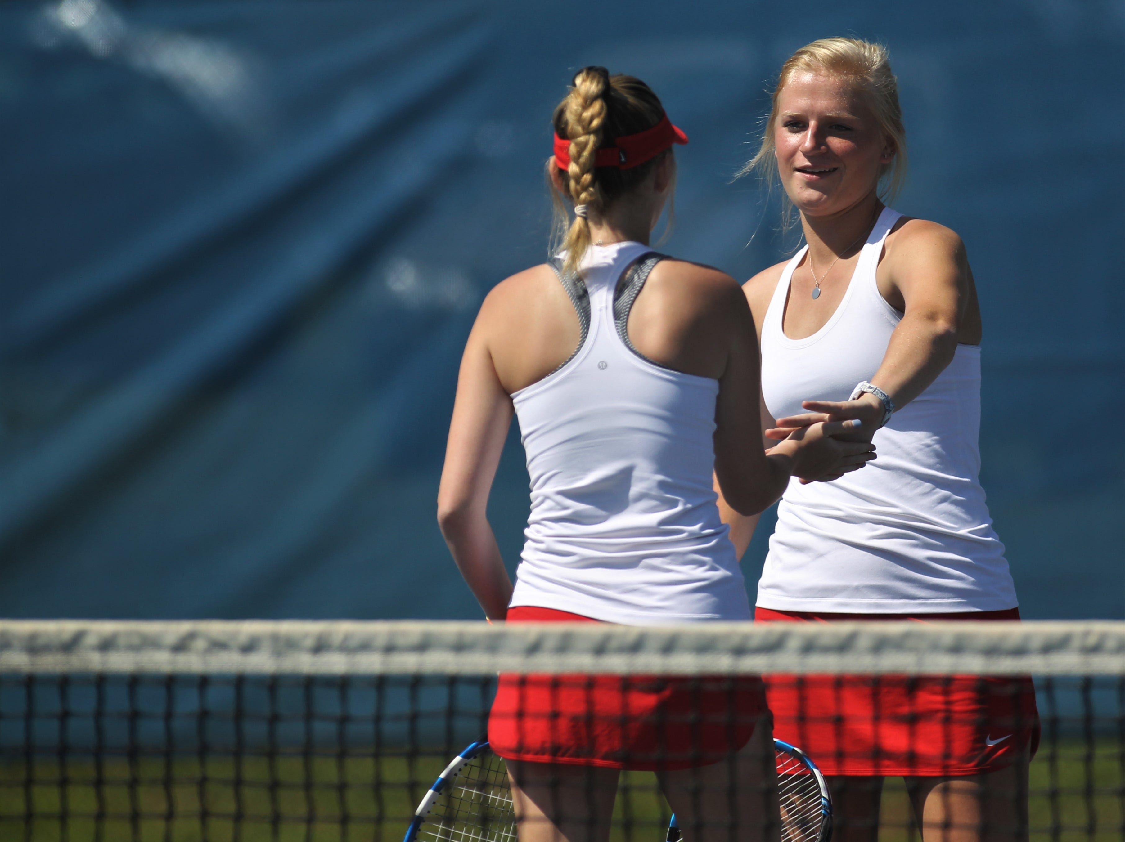 Leon senior Jules Grady congratulates doubles partner Abby Birkmeier after a point during the boys and girls tennis 2019 City Tournament at Tom Brown Park on March 12, 2019.
