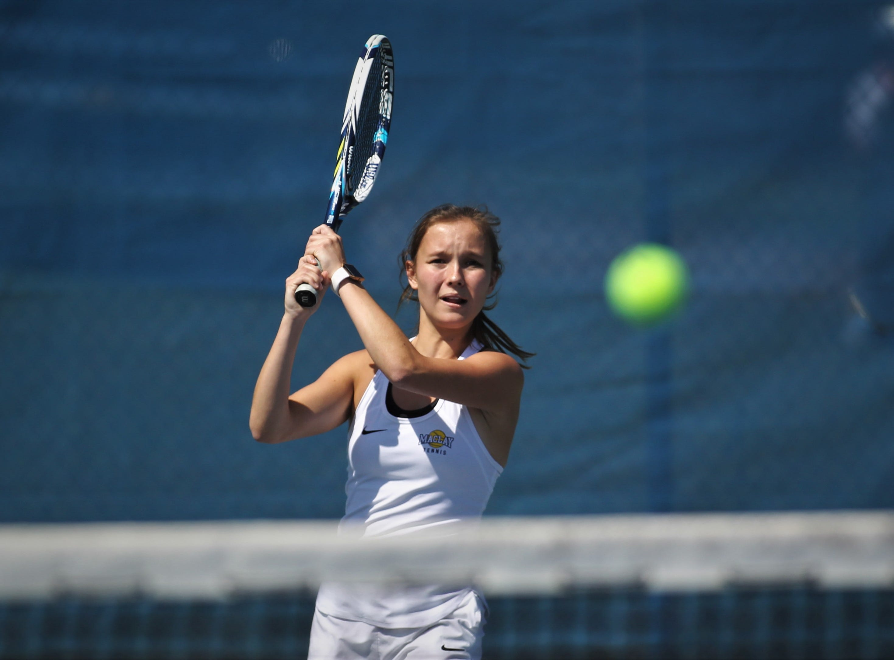 Maclay's Rachael Stockel watches a return shot during the boys and girls tennis 2019 City Tournament at Tom Brown Park on March 12, 2019.