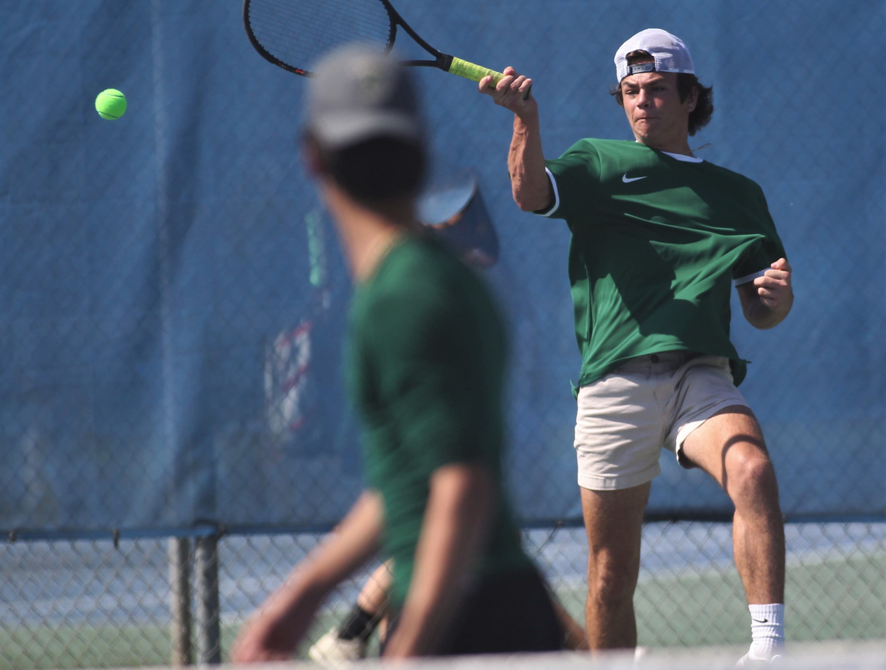 Lincoln's Jay Peacock hits a return shot during the boys and girls tennis 2019 City Tournament at Tom Brown Park on March 12, 2019.