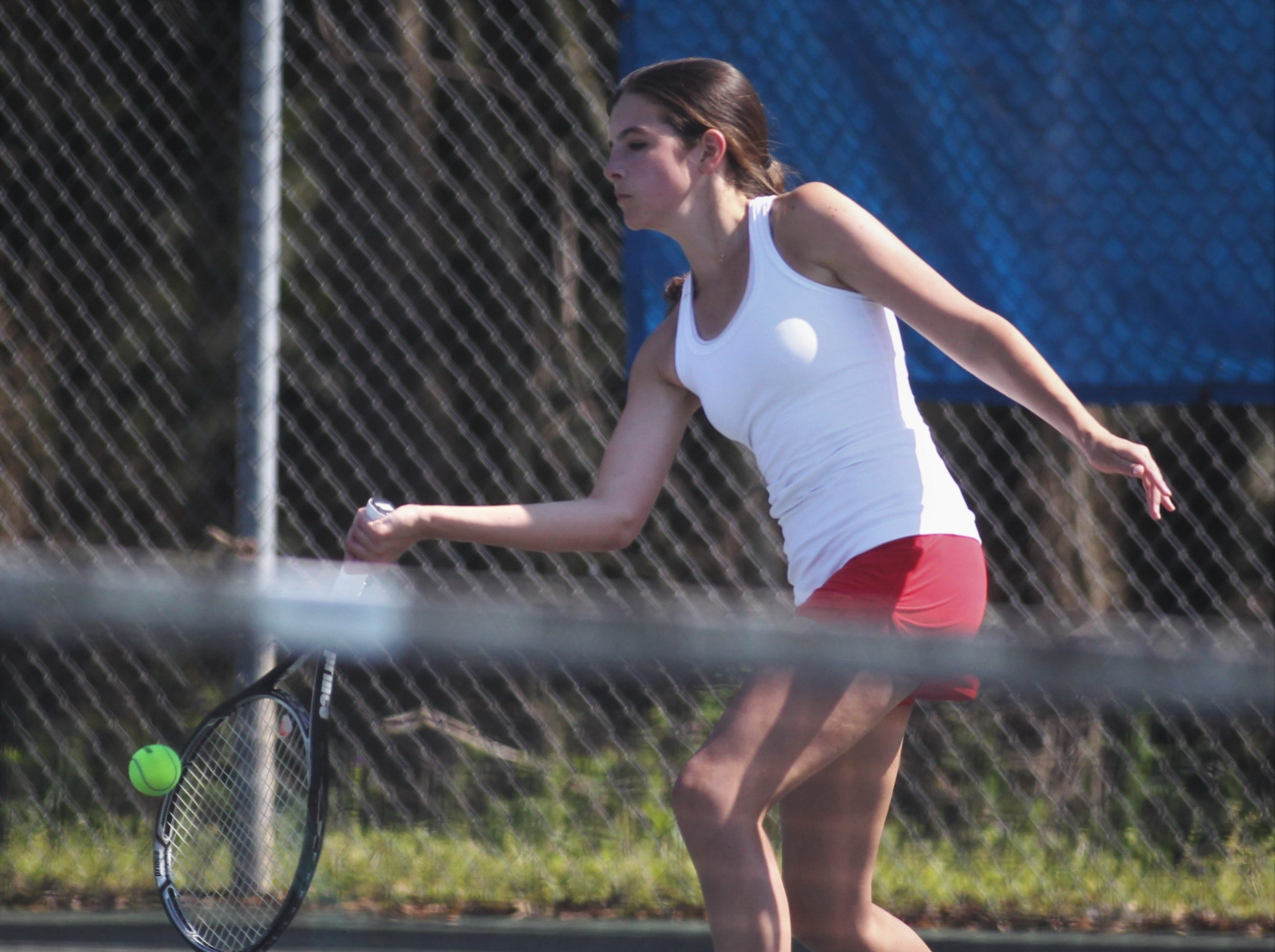 Leon's Carsyn Kenny plays during the boys and girls tennis 2019 City Tournament at Tom Brown Park on March 12, 2019.