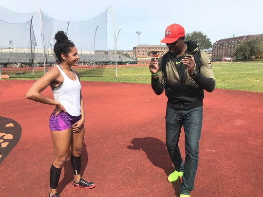 FAMU high jumper Catherine Bryant talks with assistant coach Chris Garye about body positioning during practice on Wednesday, March 13, 2019. Bryant will compete in the FAMU Relays March 15-16.