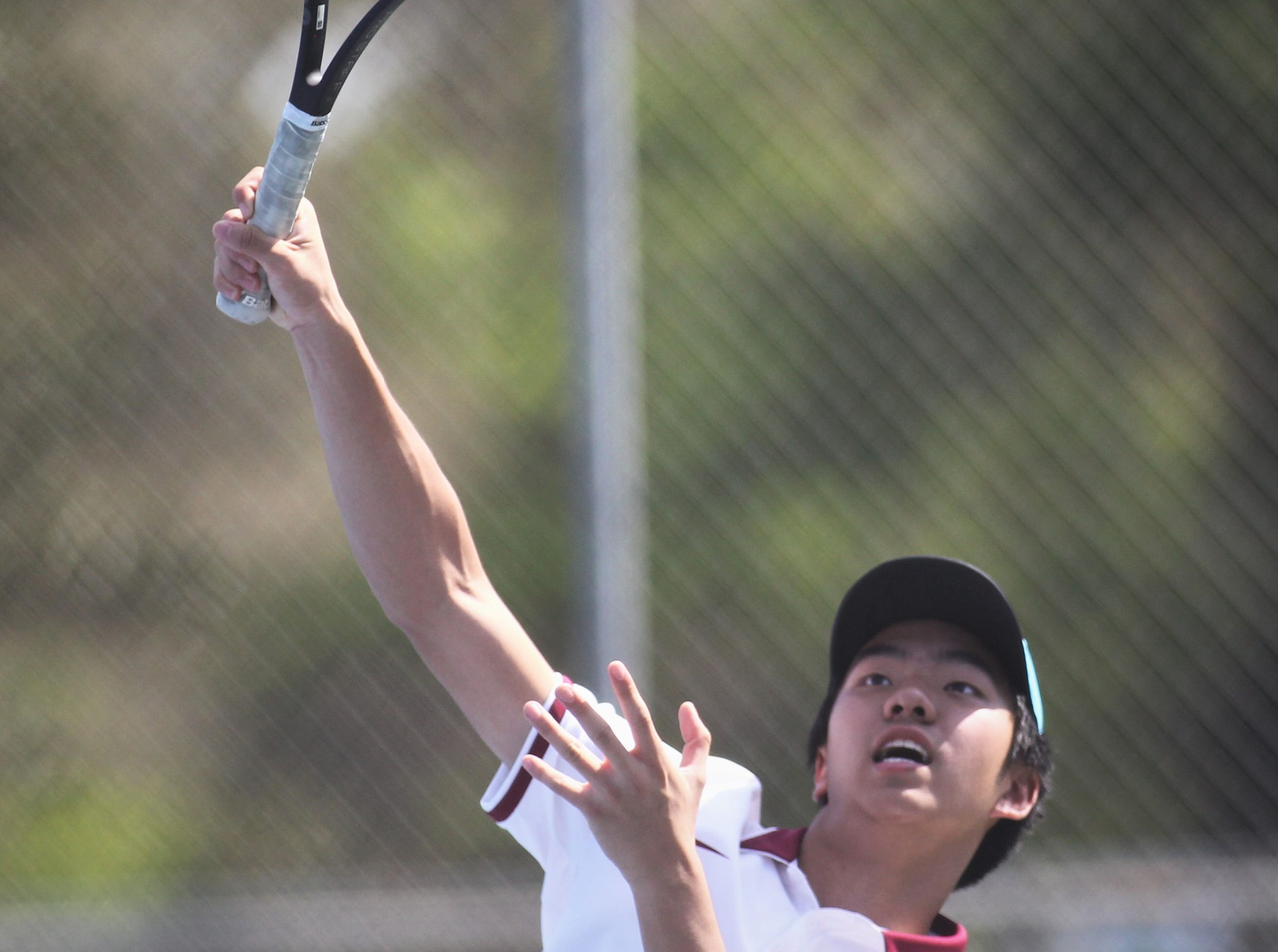Chiles freshman Brighton Jiang hits a shot during the boys and girls tennis 2019 City Tournament at Tom Brown Park on March 12, 2019.