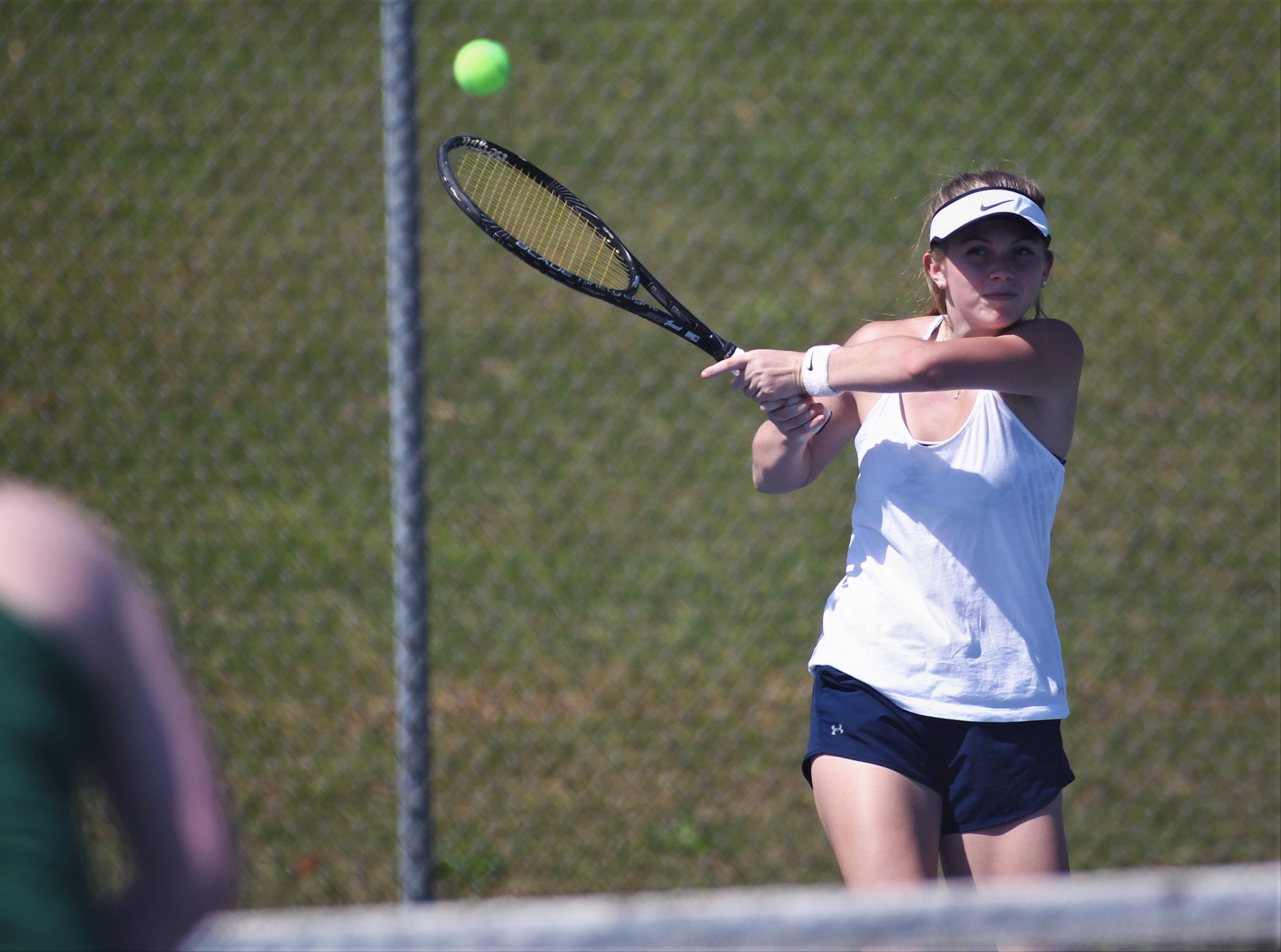 St. John Paul II senior Tiffany Stout plays a backhand shot during the boys and girls tennis 2019 City Tournament at Tom Brown Park on March 12, 2019.