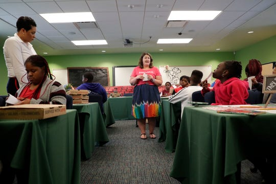 Danielle Hess, reading coach at Pineview Elementary, explains to the students the next steps in their activity. Pineview Elementary makes learning fun by doing a pizza-themed 'book tasting' to help get students excited about reading Wednesday, March 13, 2019.