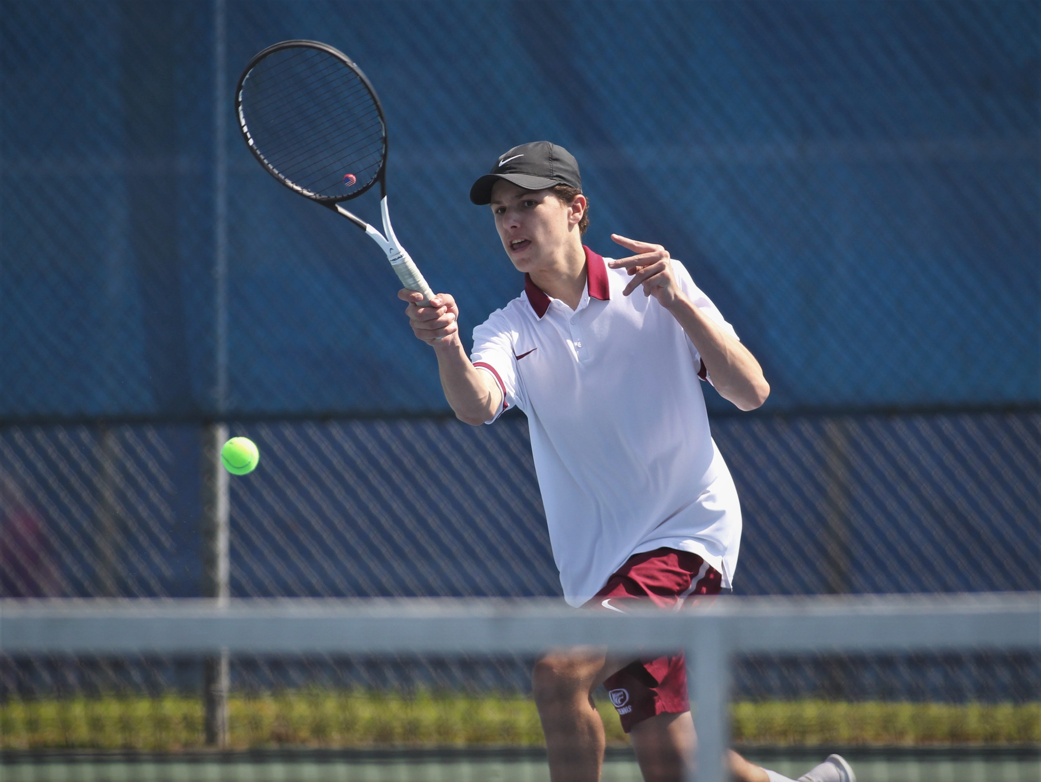 Chiles sophomore Chris DeCardenas hits a shot during the boys and girls tennis 2019 City Tournament at Tom Brown Park on March 12, 2019.