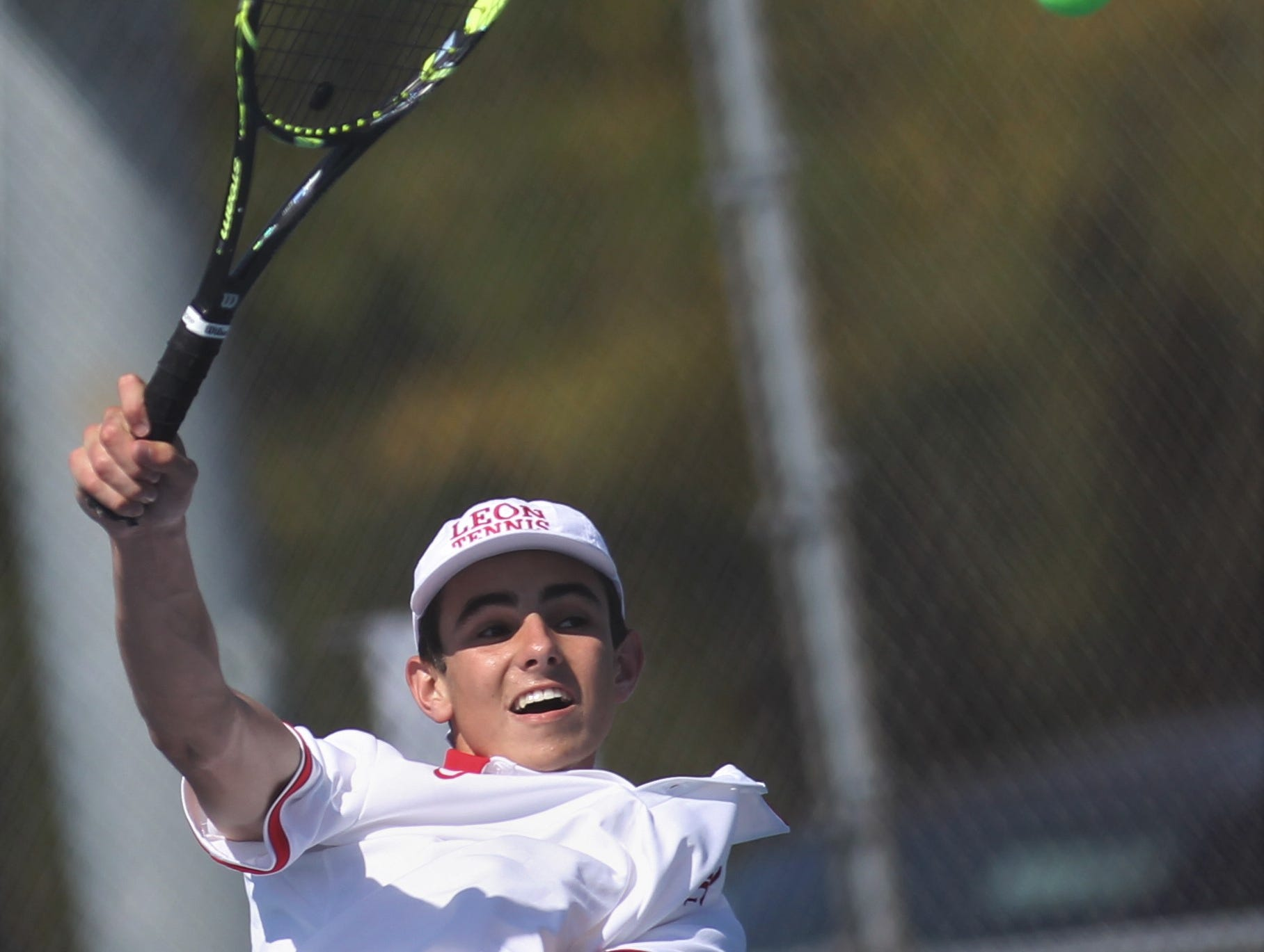 Leon sophomore Parker Kenny hits a shot during the boys and girls tennis 2019 City Tournament at Tom Brown Park on March 12, 2019.