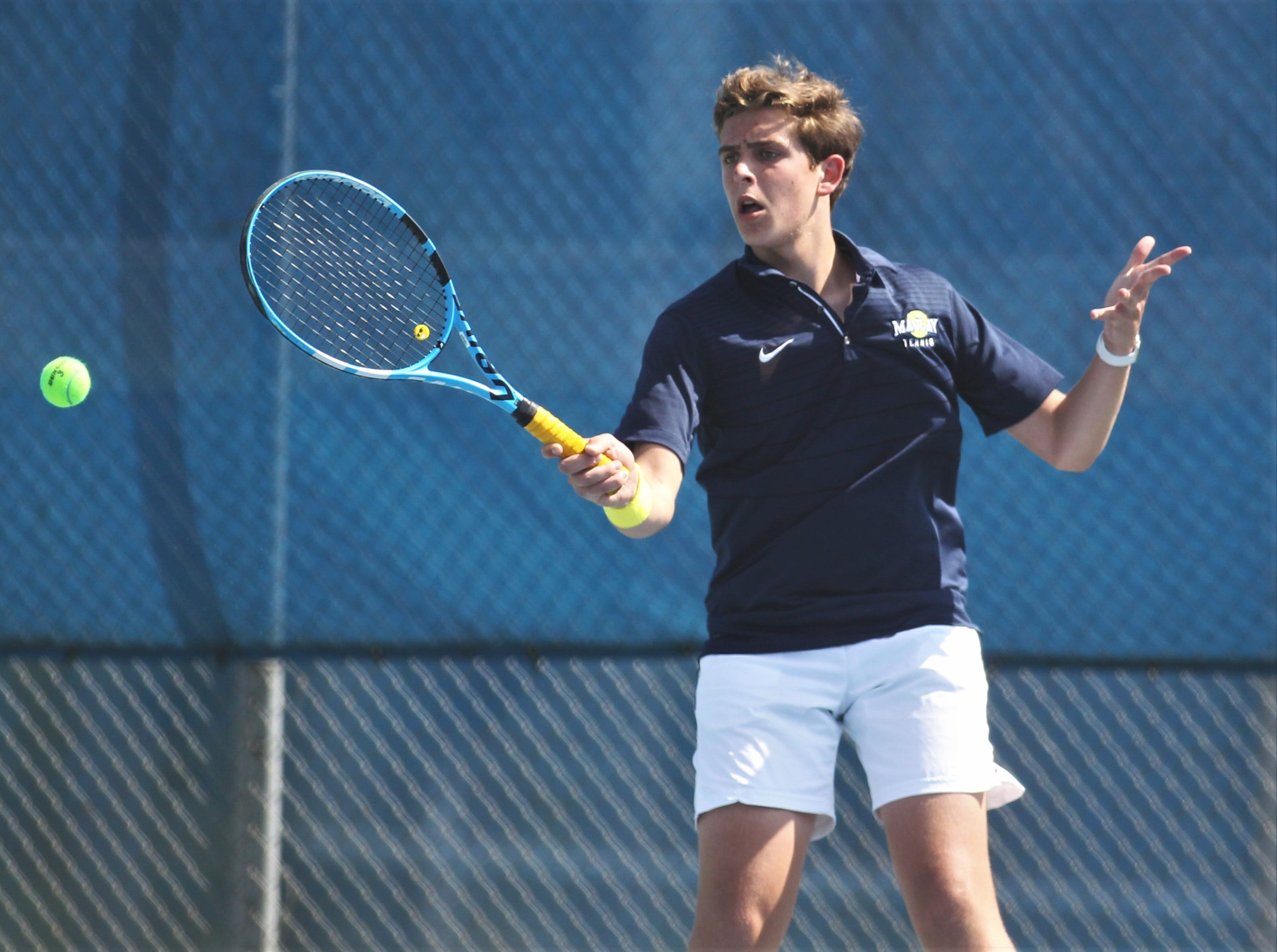Maclay's Nick Cicchetti hits a forehand during the boys and girls tennis 2019 City Tournament at Tom Brown Park on March 12, 2019.