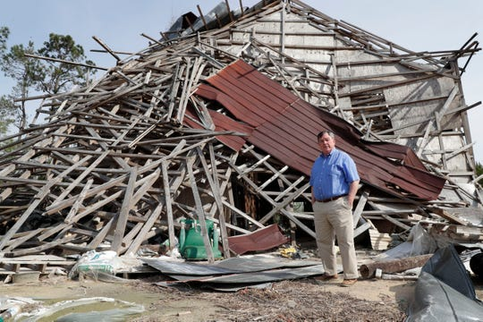 George Hackney, owner of Hackney Nursery located in Quincy, Fla., stands in front of a barn which was used to store fertilizer is still in shambles Wednesday, March 13, 2019.  Gadsden County continues to recover from Hurricane Michael which hit the Panhandle in Oct. 2018.