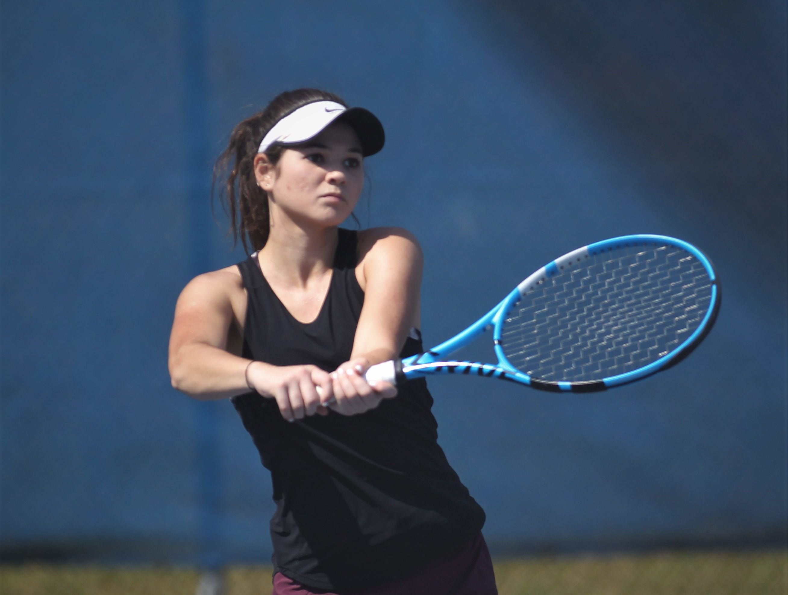 Chiles senior Gracie Wilson hits a return shot during the boys and girls tennis 2019 City Tournament at Tom Brown Park on March 12, 2019.