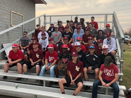 The Liberty County and Blountstown baseball teams Tuesday at Liberty County's field following the Bulldogs practice.