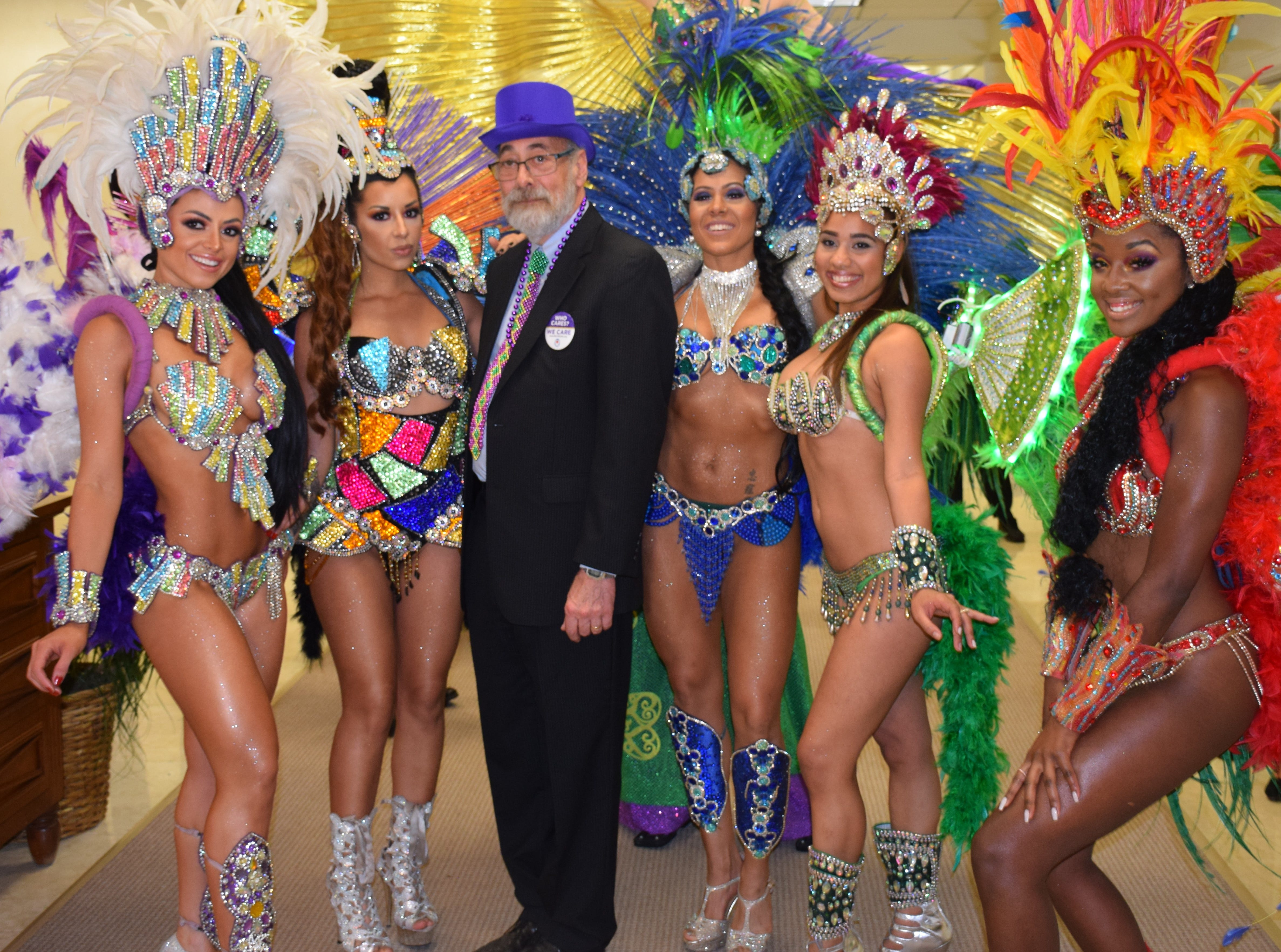 Dr. Denis Saver surrounded by members of the Phoebe samba team.