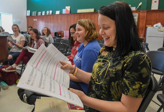 "Choir students (from right) Natili Kempf, 15, Desi Bollinger, 16, and Alexa Roth, 14, rehearse the song 'Gloria' along with eight others, during choir practice Wednesday, March 13, 2019, at Indian River Charter High School. These eleven students, along with 36 others in the Indian River Charter High School Concert Choir, made a trip to Carnegie Hall in New York City to perform on March 31.  ""It's really cool, because I get to go to Carnegie Hall and perform in front of a bunch of people doing what I love to do,"" Kempf said. ""It's a big place to perform."""