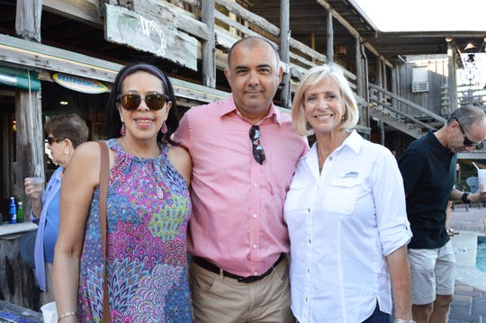 Denise King, left, Taner Kizar and Elaine Jones at the United Against Poverty Splash party at Waldo's Restaurant.