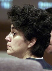 Socorro Caro listens during her murder trial at Ventura County Superior Court on Oct. 2, 2001, in Ventura, Calif.